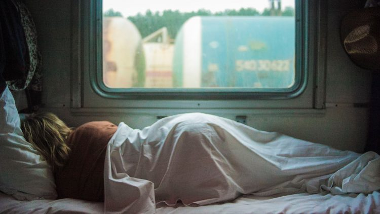 Woman Sleeping on a Train